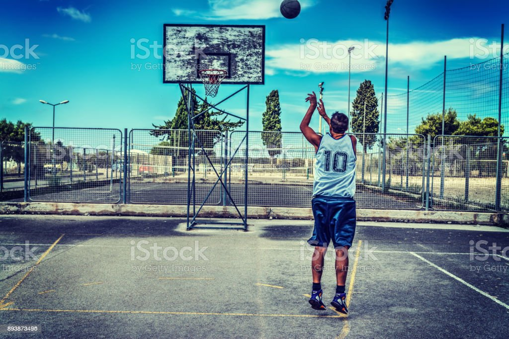 Jump shot in a basketball court stock photo