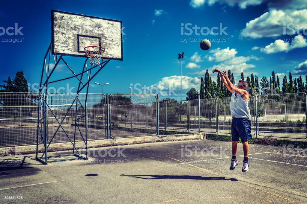 jump shot in a playground stock photo