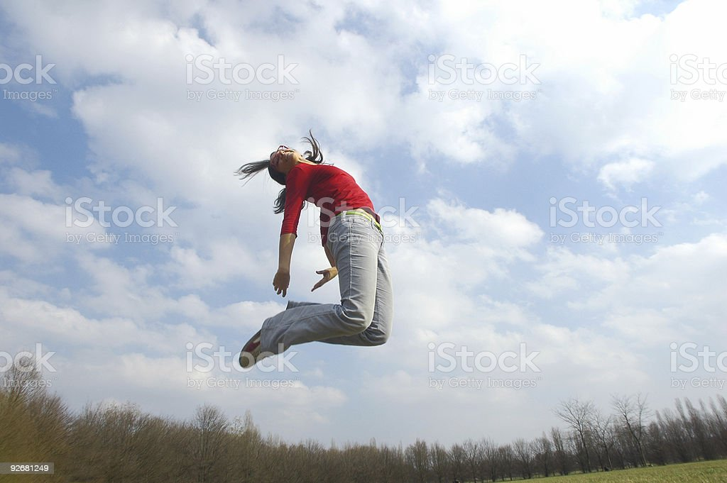 jump with clouds royalty-free stock photo