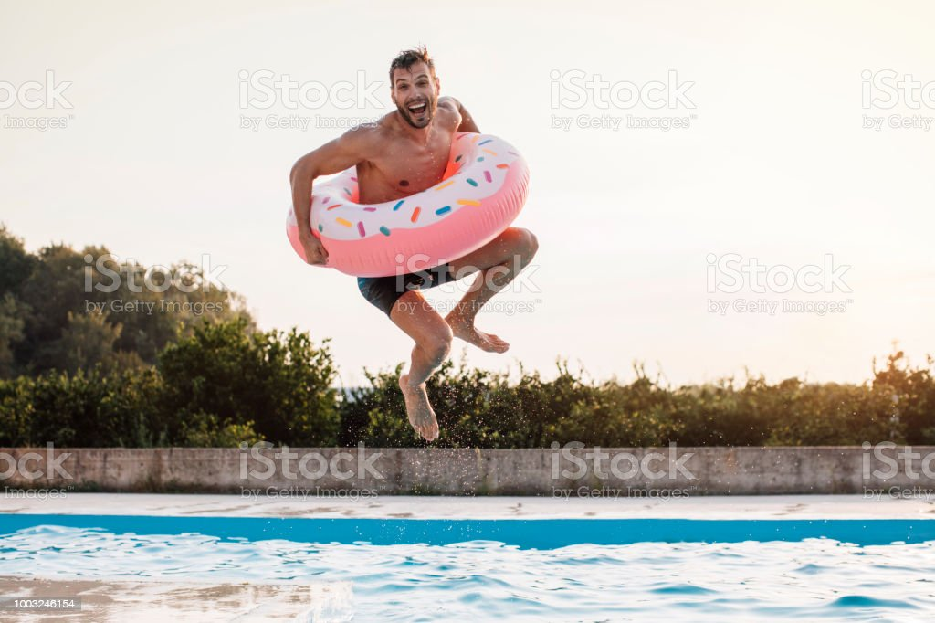 A jump with inflatable ring stock photo
