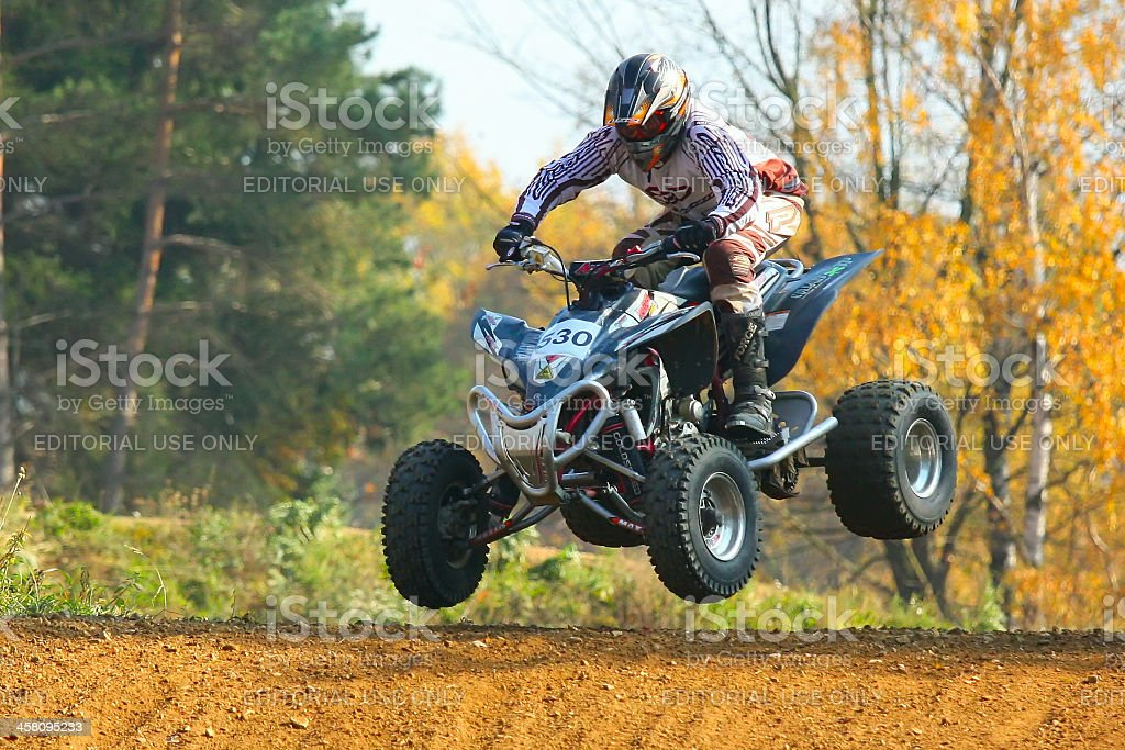 Jump with quad motorbike stock photo