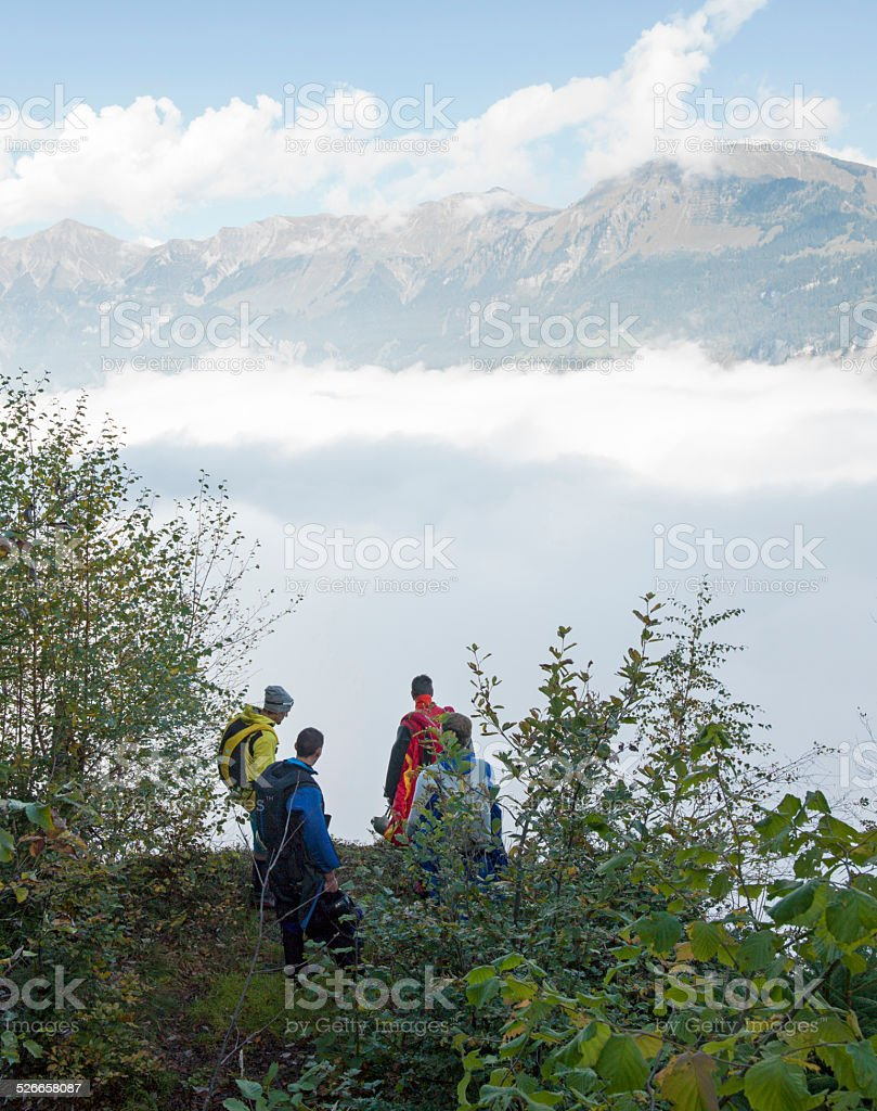 BASE jumper and wing suit fliers ponder jump stock photo