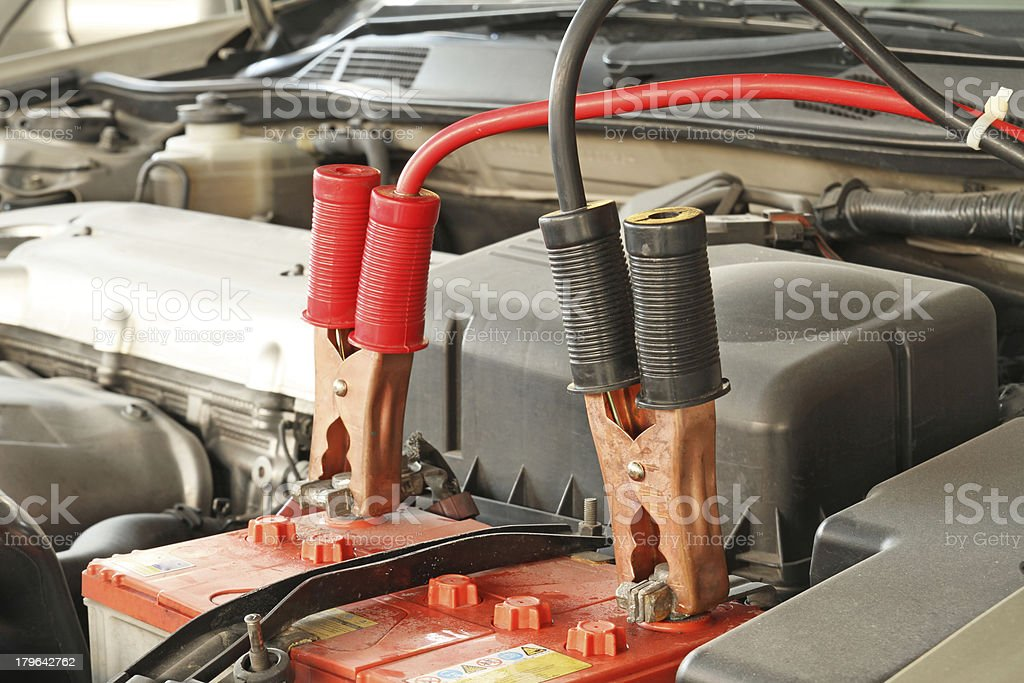 Jumper cables charging battery stock photo