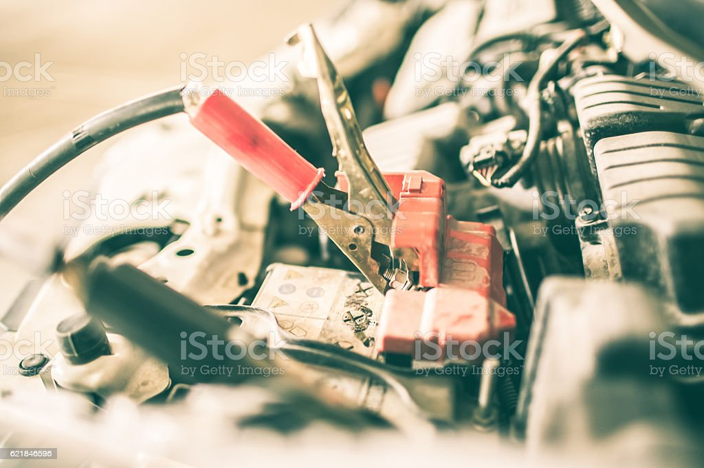 Jumper Cables Charging Car Battery stock photo
