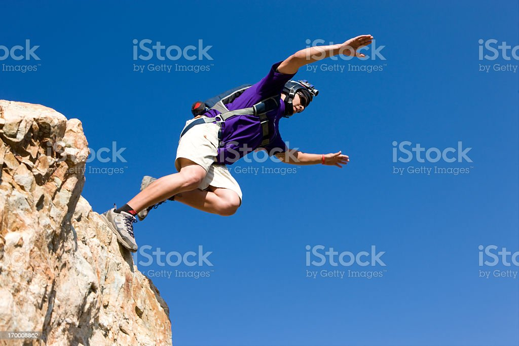 BASE Jumper Jumping Off Cliff royalty-free stock photo