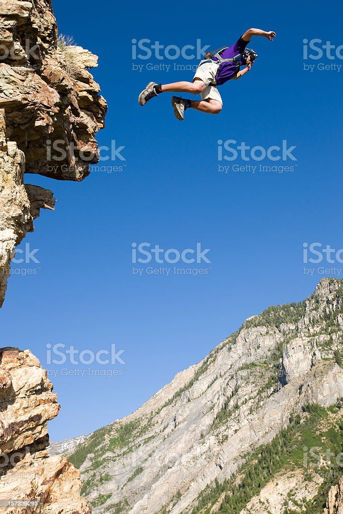 BASE Jumper Leaping Off Cliff royalty-free stock photo
