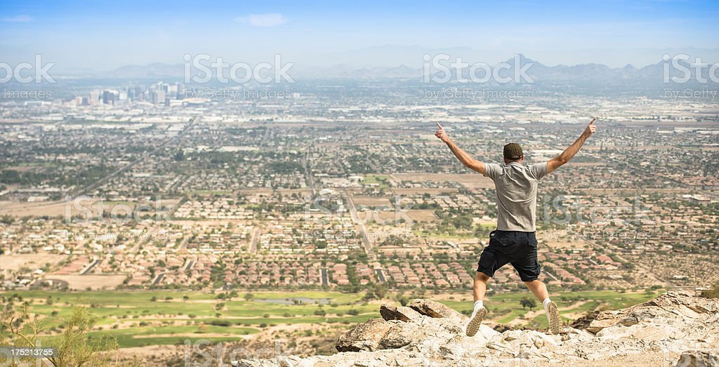jumping against the Phoenix city skyline panorama royalty-free stock photo