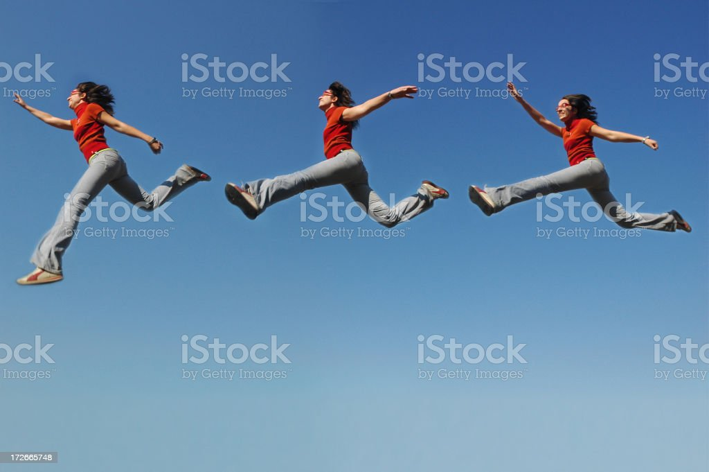jumping and flying in the sky royalty-free stock photo