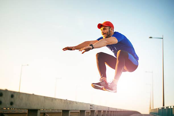 jumping and practicing parkour - parkour stock-fotos und bilder