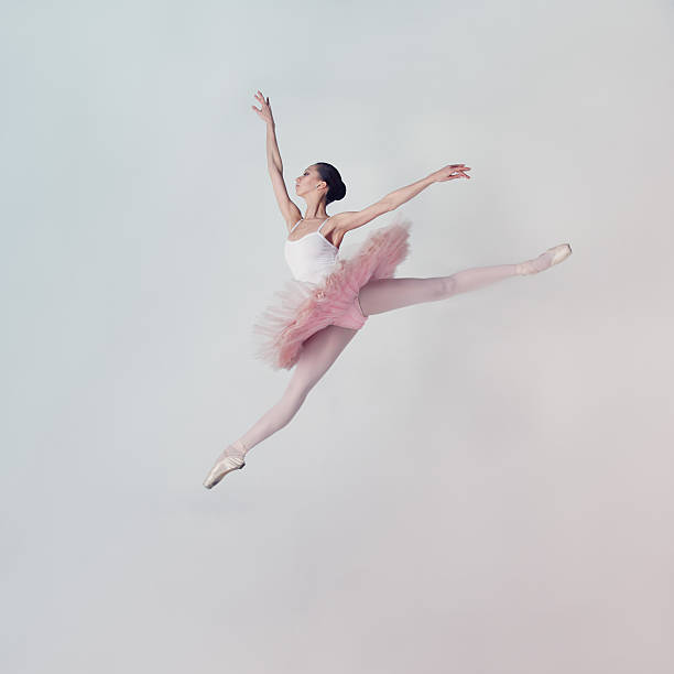 Jumping ballet dancer stock photo