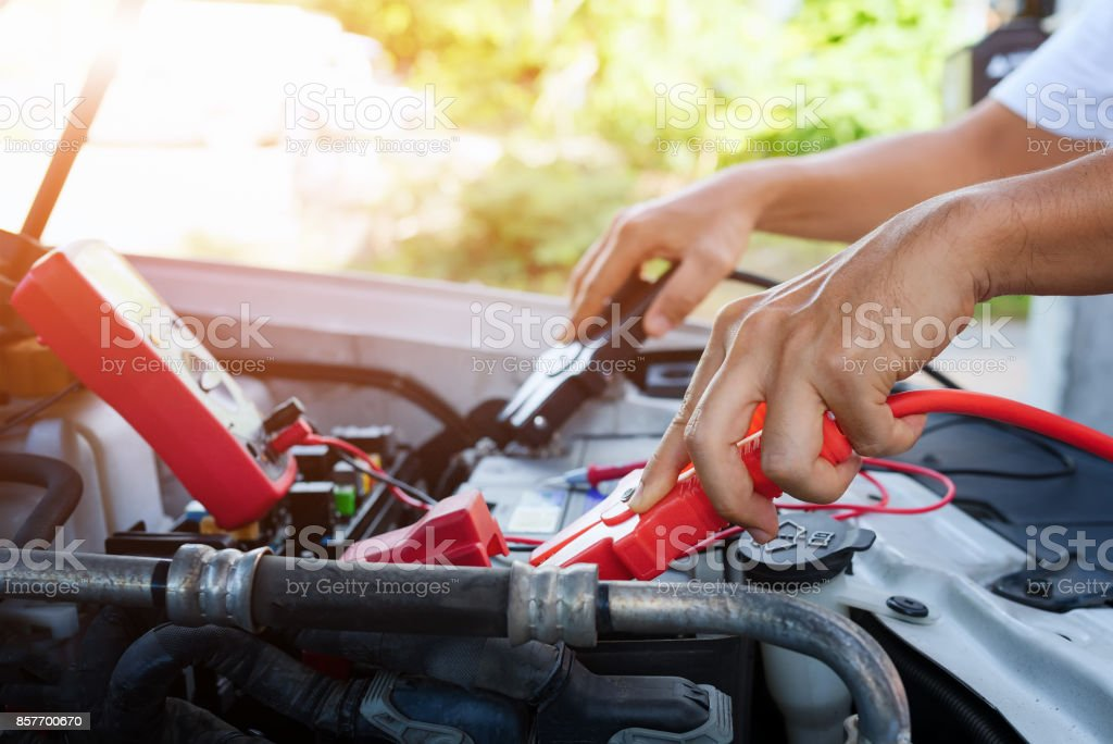 Jumping battery car. stock photo