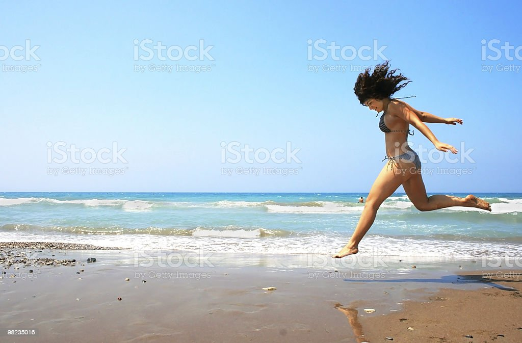 Jumping brunette girl royalty-free stock photo
