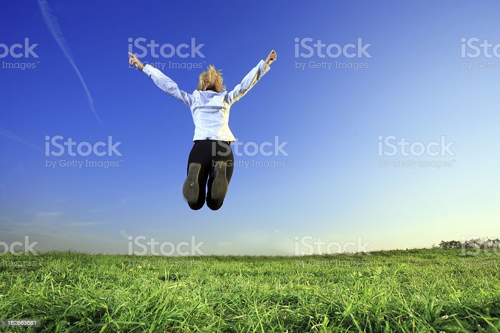 Jumping businesswoman. royalty-free stock photo