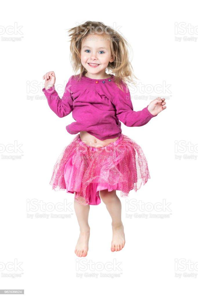 Criança em uma saia de salto - Foto de stock de Alegria royalty-free