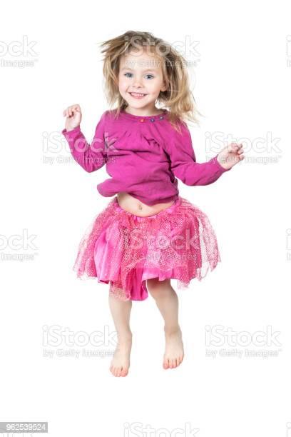 Foto de Criança Em Uma Saia De Salto e mais fotos de stock de Alegria