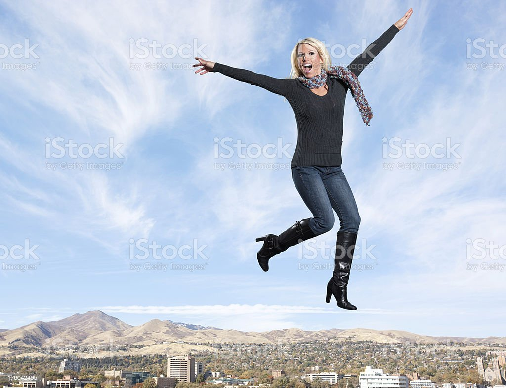 Jumping: Excited Woman stock photo