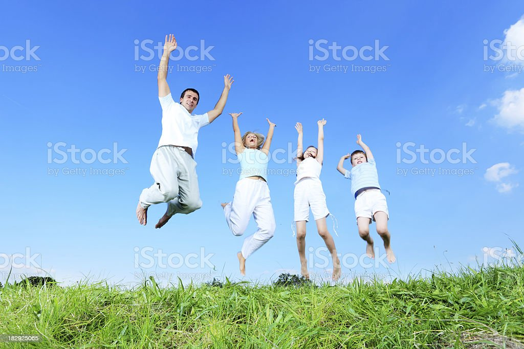 Jumping family on meadow. royalty-free stock photo