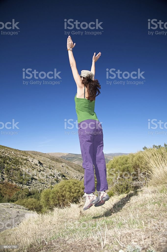 jumping female with cap royalty-free stock photo