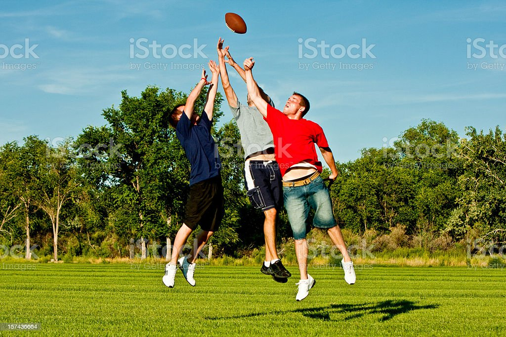 Jumping for Football stock photo