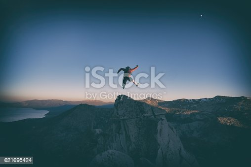 Jumping for joy over Lake Tahoe mountains