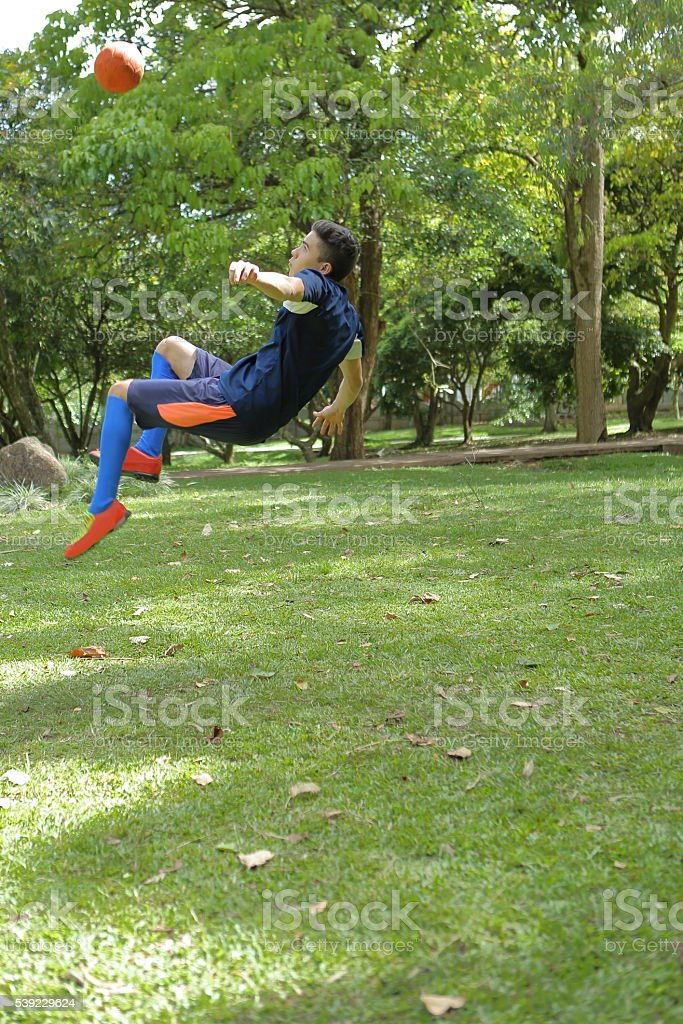 Jumping for Overhead Kick stock photo
