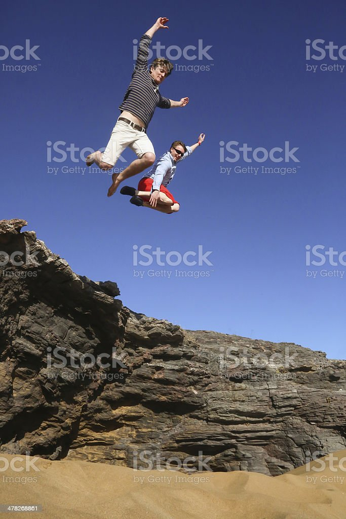 Jumping from a rock stock photo