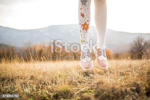 istock Jumping girl 879364762