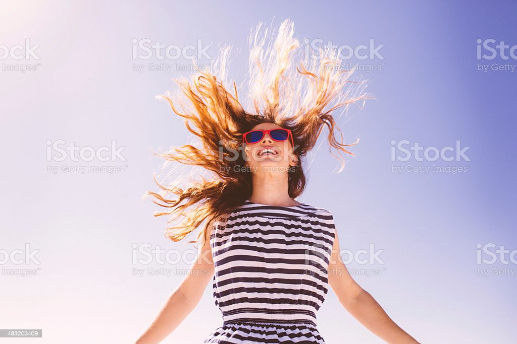 Jumping girl with flying hair stock photo