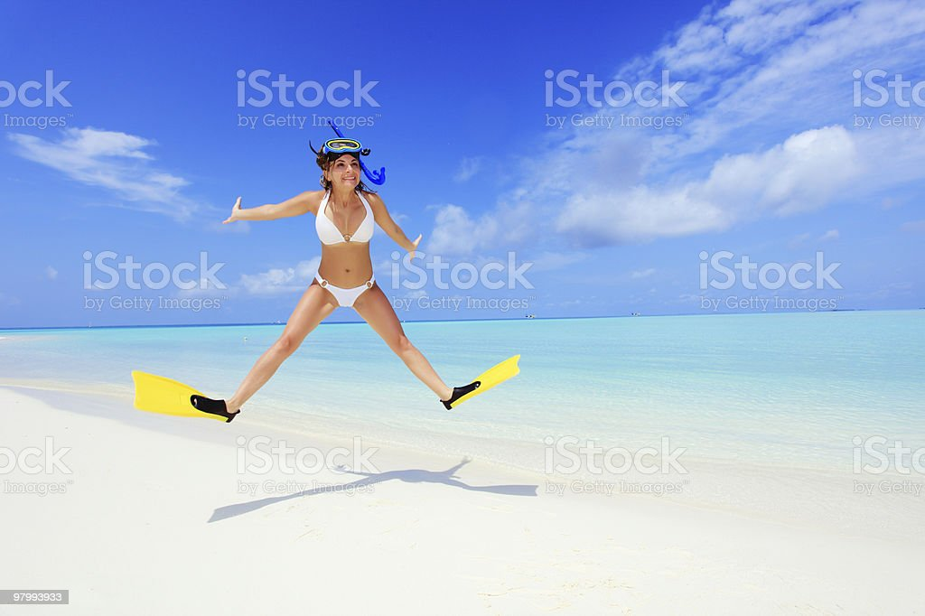 Jumping girl with mask and flippers. royalty-free stock photo