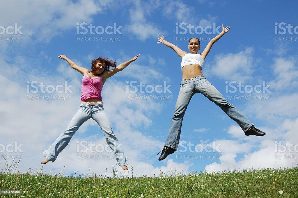 Jumping girls royalty-free stock photo
