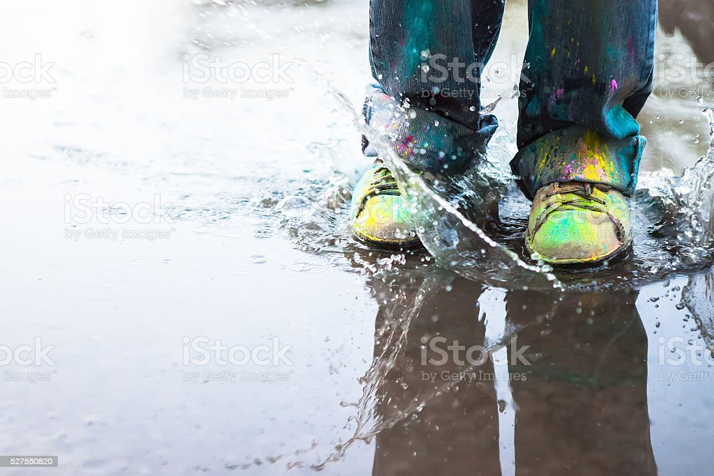 Jumping in puddle stock photo