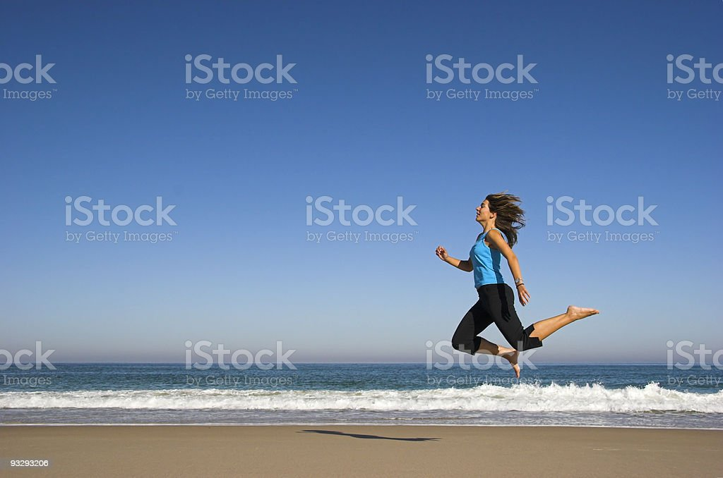 Jumping in the beach royalty-free stock photo