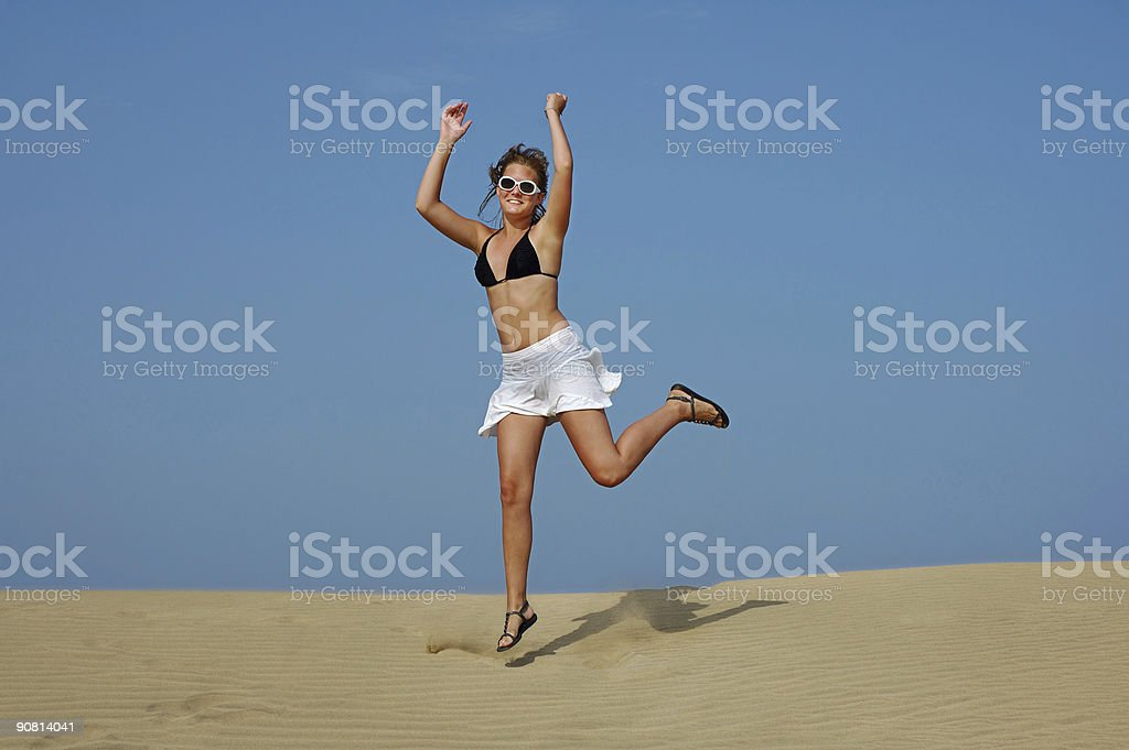 Jumping in the desert royalty-free stock photo