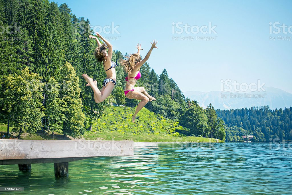 Jumping in the lake stock photo