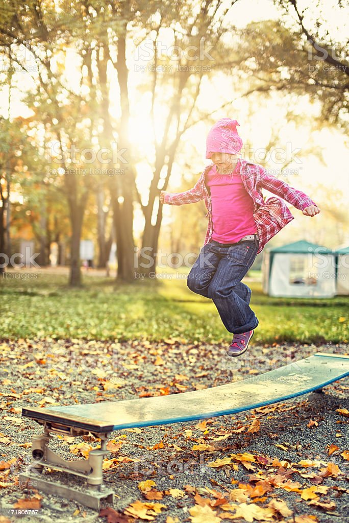 Jumping in the park royalty-free stock photo