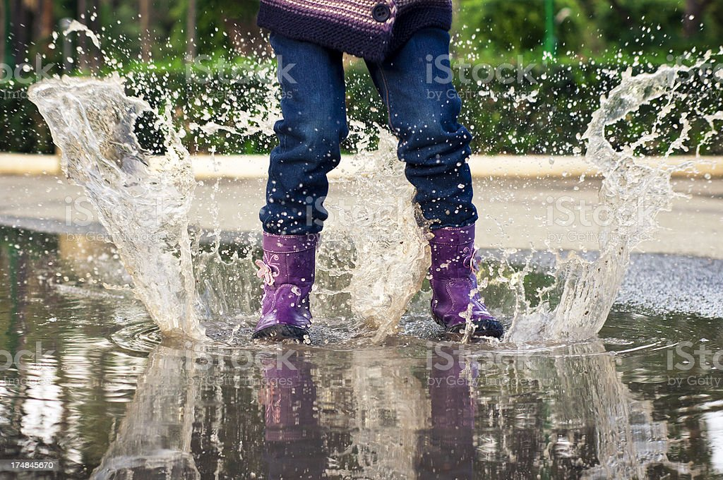 Jumping in the puddle royalty-free stock photo