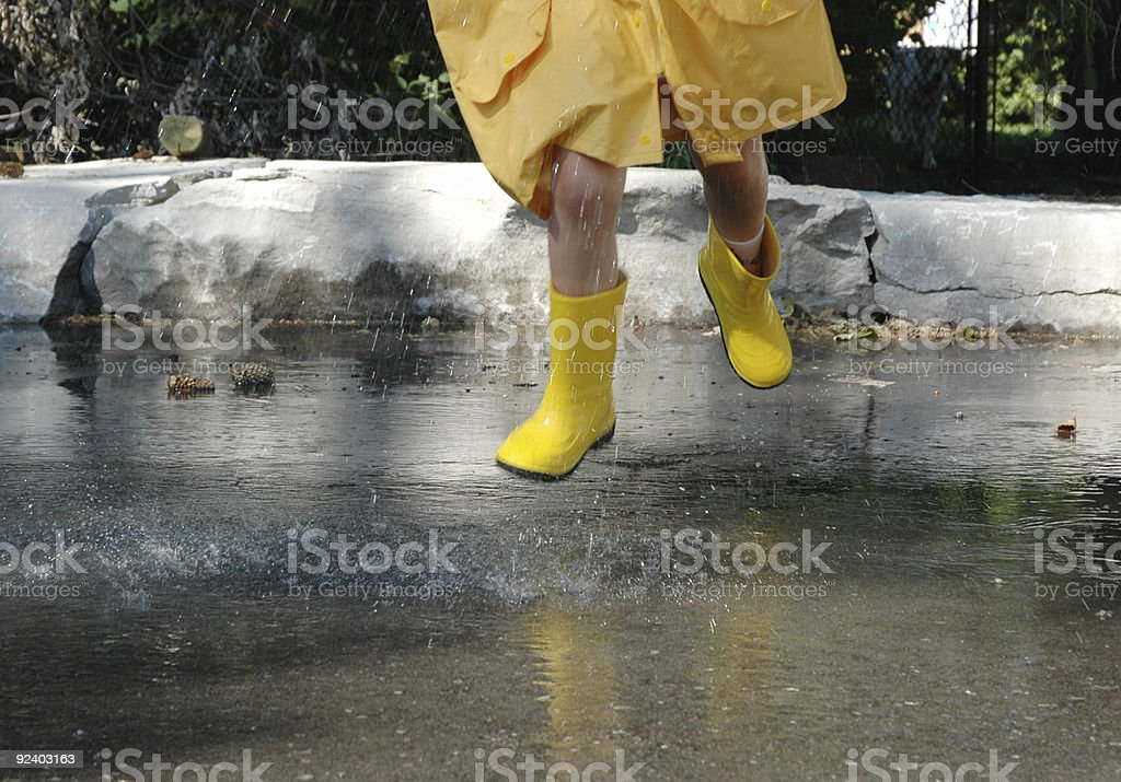 Jumping in the rain royalty-free stock photo