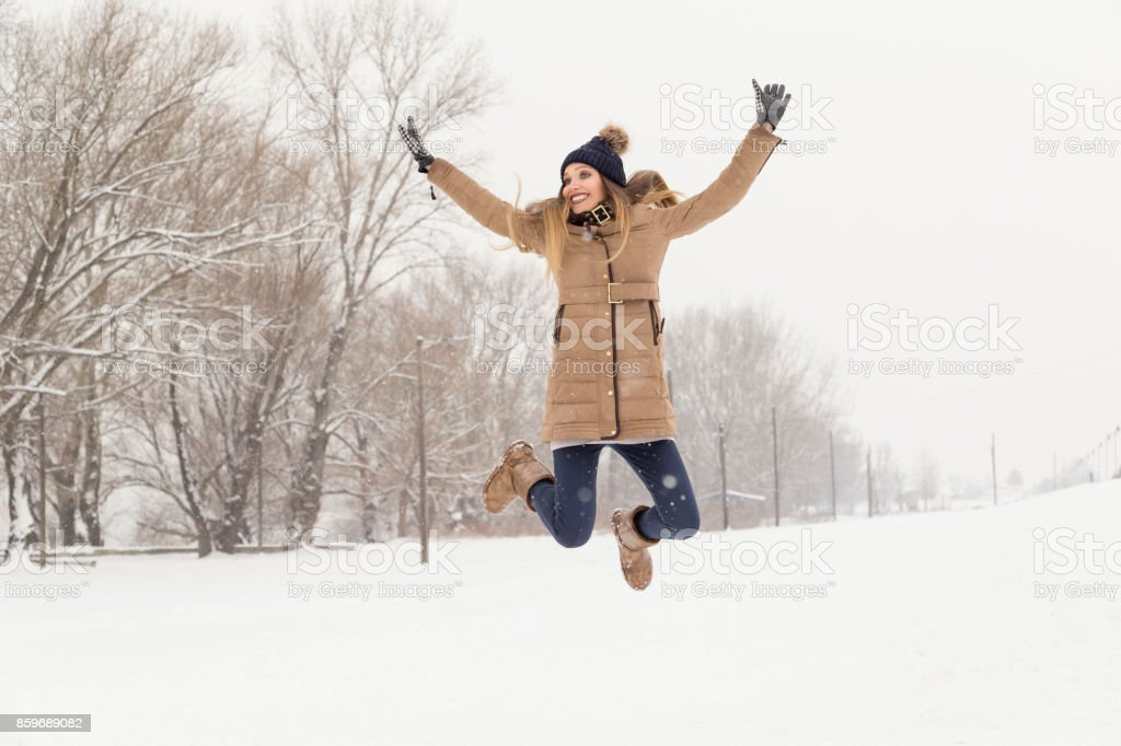 Jumping in the snow stock photo