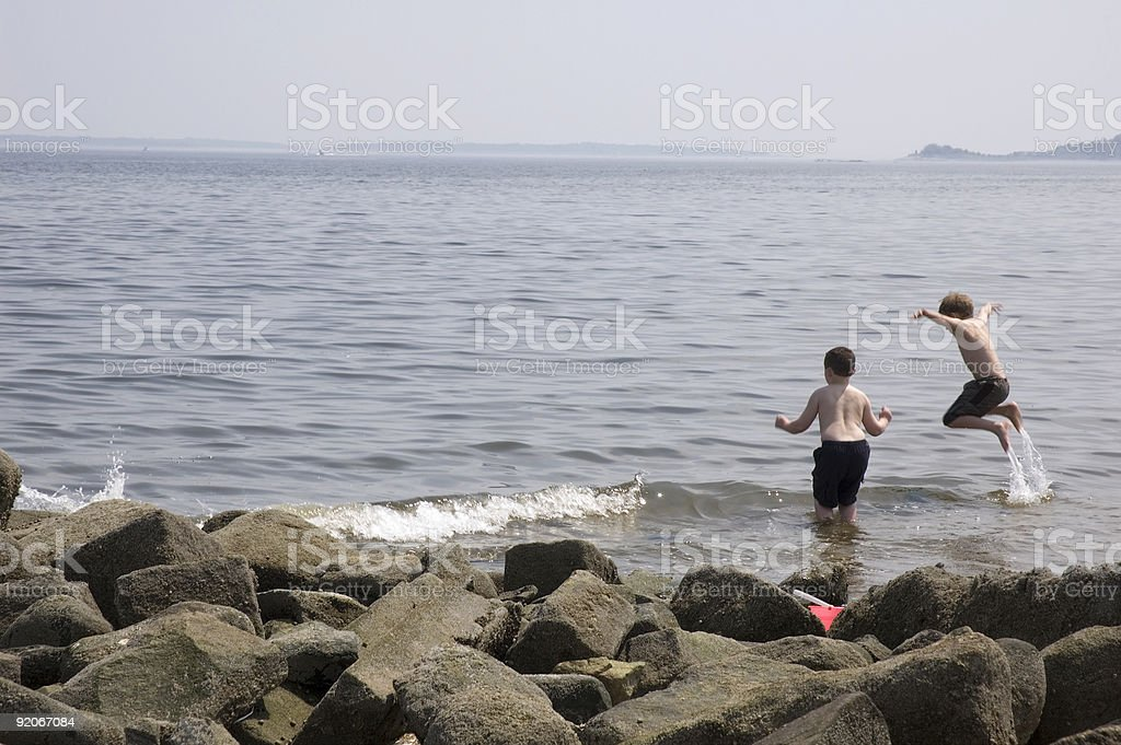 Jumping in the surf stock photo
