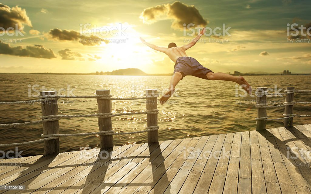 Jumping into the Ocean at Sunset, Summer Fun Lifestyle stock photo