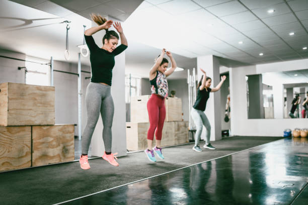 Jumping Jacks In Gym stock photo