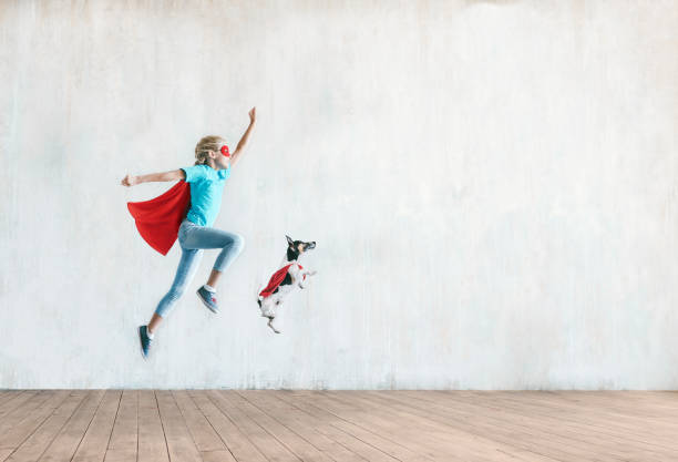 Jumping little child with a dog stock photo