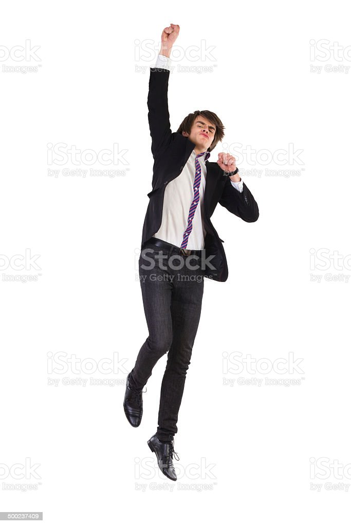 Jumping man in a suit. stock photo