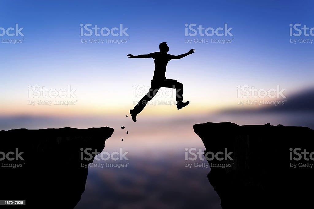 Jumping man silhouette stock photo