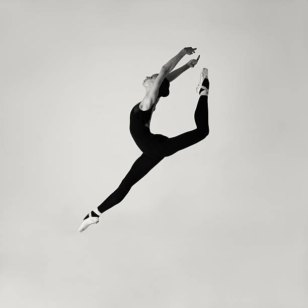 Jumping modern ballet dancer stock photo