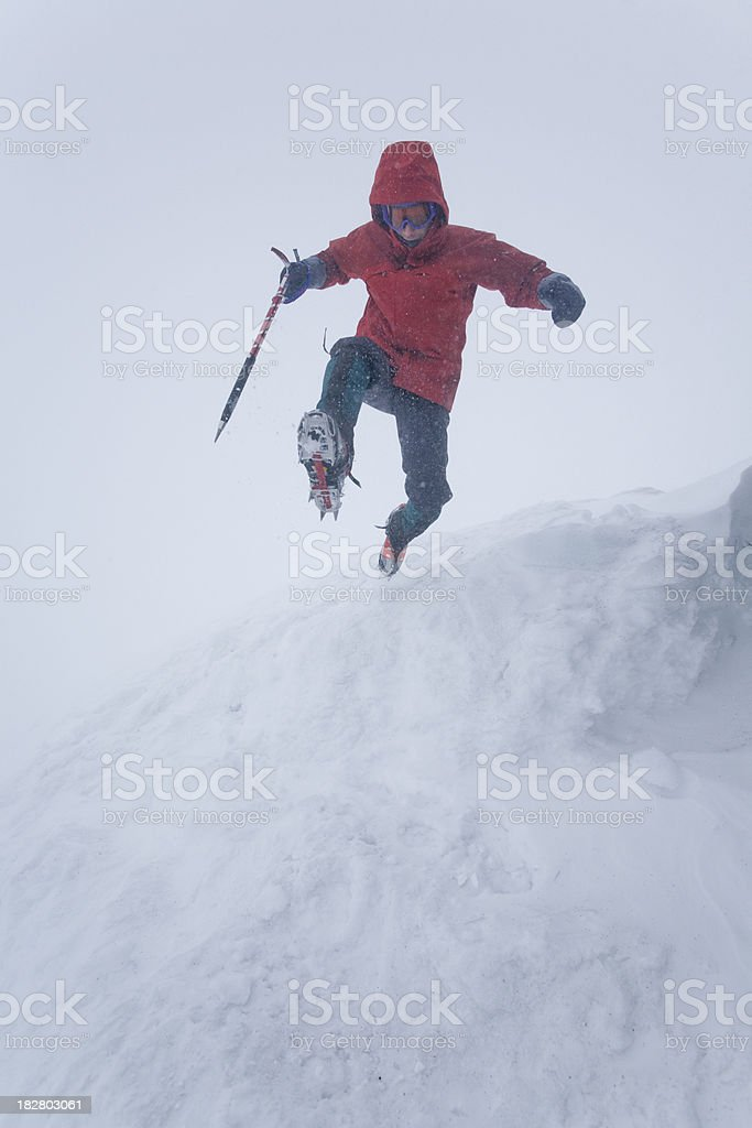 Jumping off a snow covered mountain ridge royalty-free stock photo