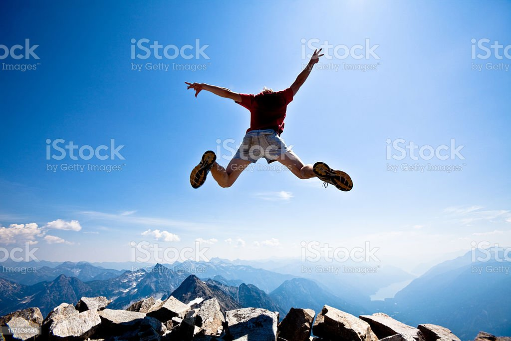 Jumping off of a mountain royalty-free stock photo