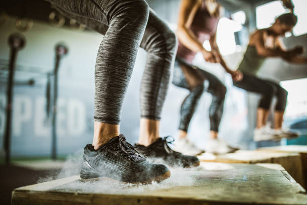 jumping on crate during sport training! - cross training stock pictures, royalty-free photos & images