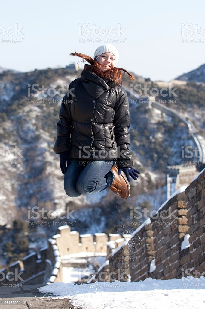 jumping on Great Wall royalty-free stock photo