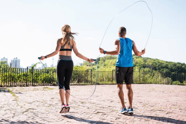 jumping on skipping ropes stock photo